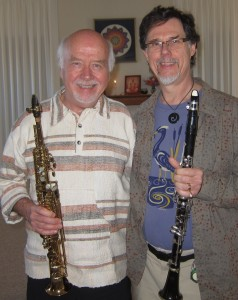 After 3 days of guiding us in improv sessions, Paul Winter shares a smile with a fellow reed player.